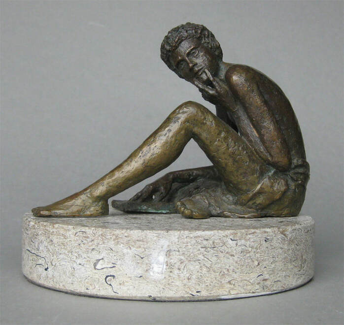 Sculpture of man reading